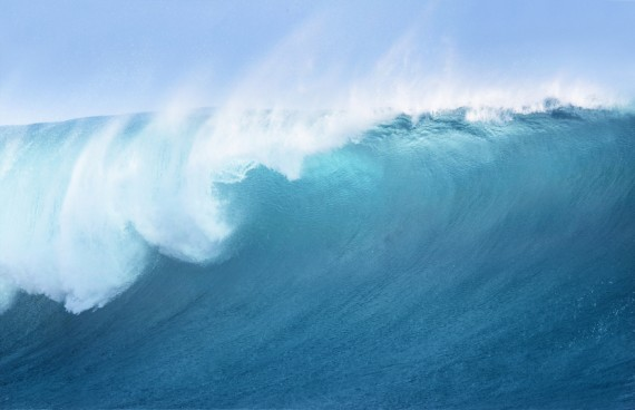 Large Blue Surfing Wave
